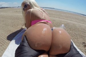 What a huge ass playing on a beach